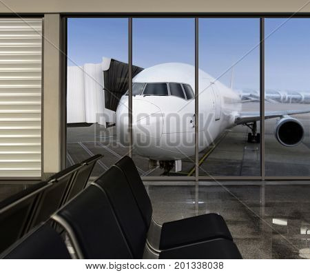 window in empty airport at morning, plane expects tourists at airport