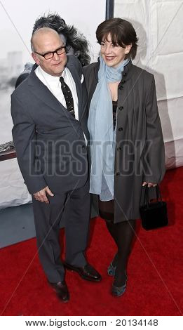 """NEW YORK - MARCH 1: Director Allen Coulter and his wife attend the movie premiere of """"Remember Me"""" at the Paris Theatre on March 1, 2010 in New York City."""