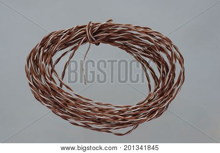 Brown and white twisted wires from the utp cable