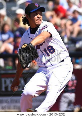 PORT ST. LUCIE, FLORIDA - MARCH 23: New York Mets pitcher Ryota Igarashi hurls a ball to the plate during the game against the Atlanta Braves on March 23, 2010 in Port St. Lucie, Florida.