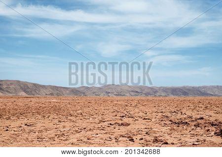 Vast arid lands of the desert under bright day light