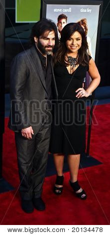 """Talk show host Rachael Ray and her husband, John Cusimano, attend the movie premiere of """"Date Night"""" at the Ziegfeld Theatre on April 6, 2010 in New York City."""