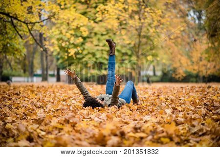 Girl lying in a park during the autumn season