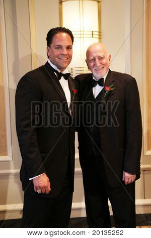 NEW YORK - MAY 8: Baseball catcher Mike Piazza and actor Dominic Chianese attend a cocktail party for the Ellis Island Medal of Honor awards at the Ritz-Carlton hotel on May 8, 2010 in New York City.