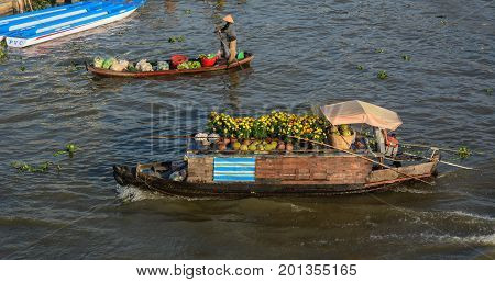 Wooden Boats On Mekong River In Vietnam