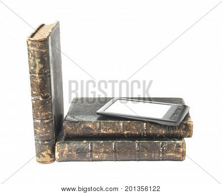 Three old books and electronic reader. Isolated on white background