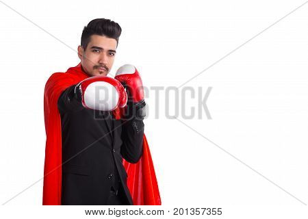 Businessman In Boxing Gloves And Superhero Red Cloak Raises Hand To Camera