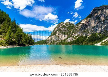 The beach of Braies lake ( Lago di Braies) in the Dolomites Italy