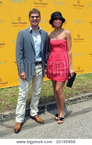 NEW YORK - JUNE 26: Singer Rob Thomas and his wife, Marisol, attend the Veuve Clicquot Polo Classic at Governor's Island on June 26, 2010 in New York City.