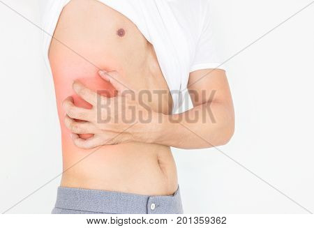 Young man scratch the itch on him body Healthcare concept.