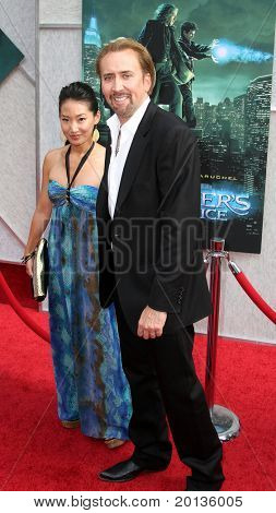 """NEW YORK - JULY 6: Actor Nicolas Cage and his wife, Alice Kim, attend the premiere of """"The Sorcerer's Apprentice"""" at the New Amsterdam Theatre on July 6, 2010 in New York City."""