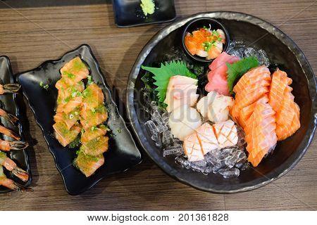 Salmon sashimi set with Salmon and Salmon caviar on big sashimi plate