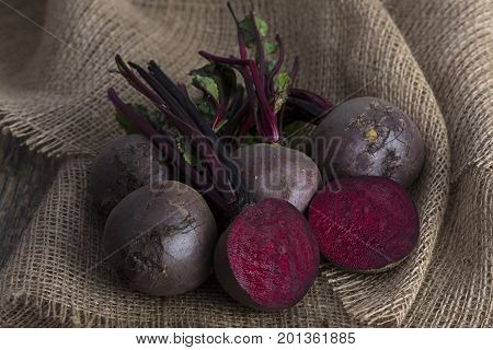 Bunch of beetroot on a brown burlap cloth with close-up