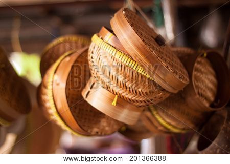 a traditional bamboo basket for rice plate hanging on the store to sell java
