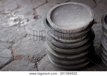 a traditional stone pestle mortar stack java