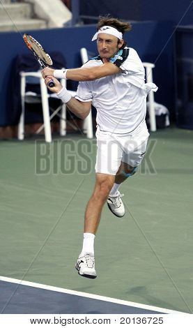 FLUSHING, NY - SEPTEMBER 4: Juan Carlos Ferrero (ESP) volleys during mens singles at the US Open Tennis Tournament at the Billie Jean King National Tennis Center on September 4, 2010 in Flushing, NY.