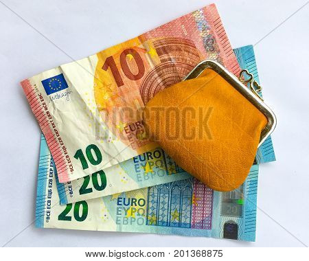 10 and 20 euros bills and purse.