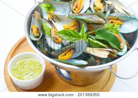 Thai Food steamed mussels with basil and lemongrass. Eaten with spicy sauce.