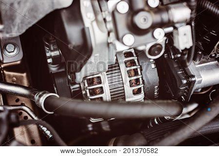 Modern car electric part alternator. Car maintenance