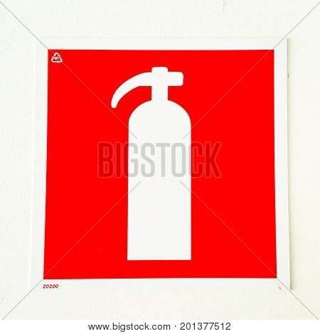 fire extinguisher sign. red and white colors.