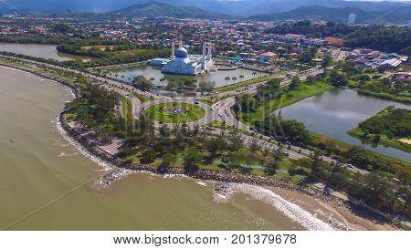 Kota Kinabalu,Sabah,Malaysia-Jan 23,2017:Aerial view from coastline roundabout with car & Kota Kinabalu State Mosque during sunny in Kota Kinabalu,Sabah,Borneo,Malaysia.