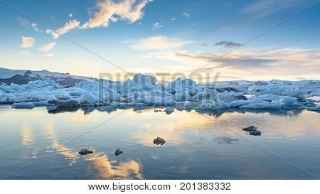 Beautiful view of icebergs in Jokulsarlon glacier lagoon at sunset Iceland global warming concept selective focus