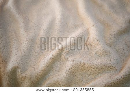 Fabric Texture Close Up of Light Brown Cozy Blanket Fabric Texture Pattern.