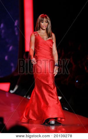 NEW YORK - FEBRUARY 9:  Rapper/Actress Eve walks the runway at The Heart Truth's Red Dress Fashion Show during Mercedes-Benz Fashion Week at Lincoln Center on February 9, 2011 in New York City.