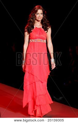 NEW YORK - FEBRUARY 9:  Actress Denise Richards walks the runway at The Heart Truth's Red Dress Fashion Show during Mercedes-Benz Fashion Week at Lincoln Center on February 9, 2011 in New York City.