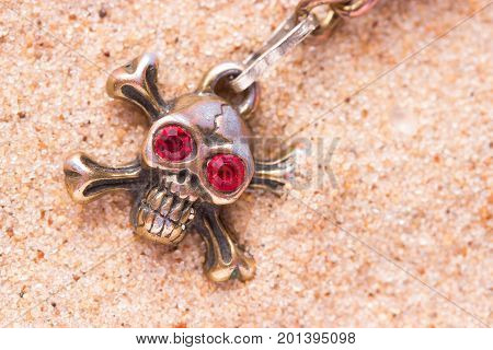 Close Up Of Metal Skull With Red Eyes