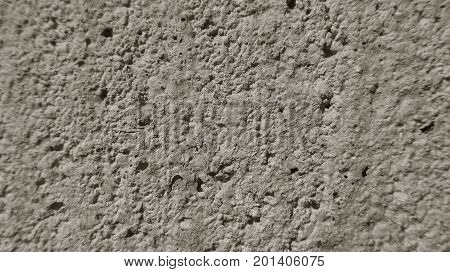 Gray porous wall from the concrete. Lunar surface.