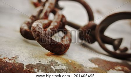 Freedom from old rusty shackles. Monochrome photo.