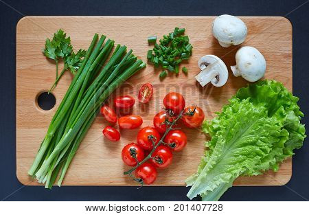 Fresh And Tasty Tomatoes, Salad, Onion, Champignon, Parsley On Wooden Cutting Board