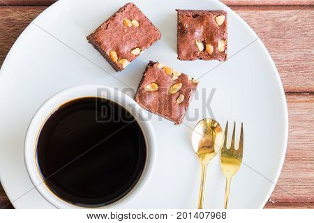 Close up brownies cake with cup of coffee