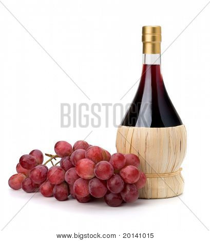 Full red wine bottle and grapes isolated on white background
