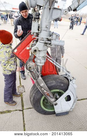 Chassis Of A Military Aircraft. Child At The Wheel Of The Chassis. Su-35 Fighter At The Air Show. Ai