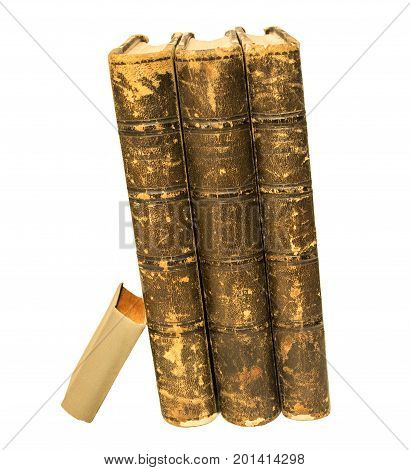 Three big old books and one little book