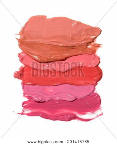 Smudged of different shades lipstick isolated on white background