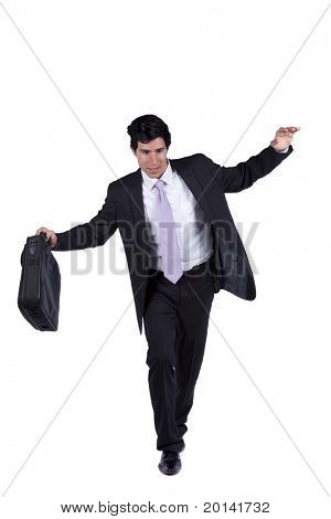 Businessman with slow walking with fear from falling (isolated on white)