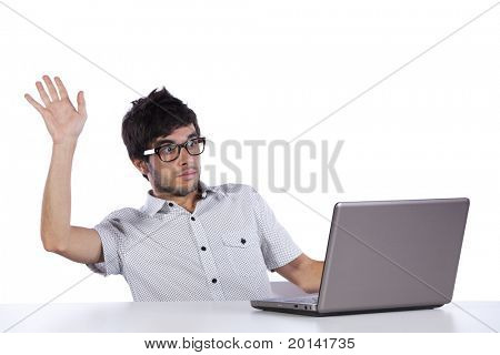 Young man looking to something terrible at his laptop