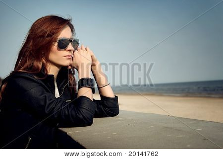 attractive woman relaxing on beach