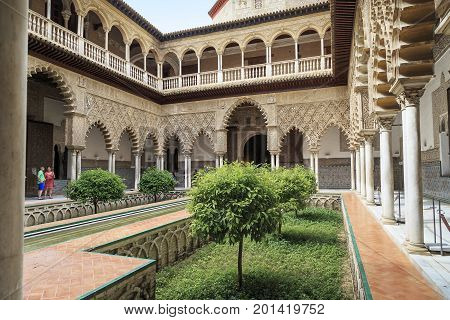 SEVILLE, SPAIN - MAY 21, 2017: This is the Maiden's Court in the Moorish Palace of the Seville Alcazar.