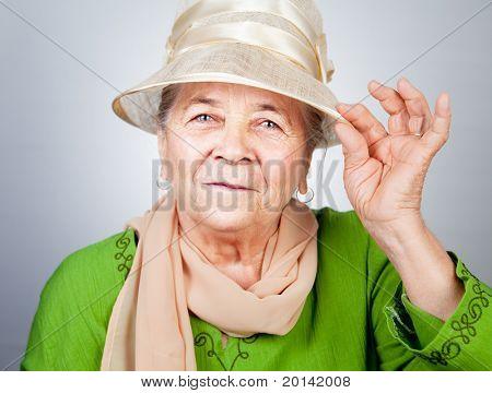 Happy joyful old senior lady in elegant nice clothes