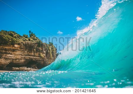 Blue ocean wave at tropical sand beach. Clear wave in tropics