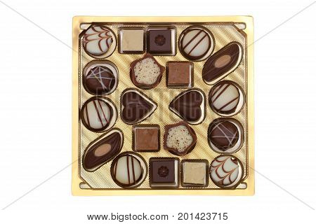 Box of assorted white, milk and dark chocolates, pralines and truffles isolated on white