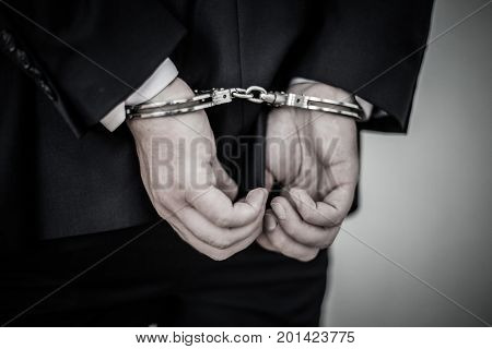 Businessman Arrested Handcuffs On The Hands Back For White Collar Crimes Counterfeiting And Corrupti