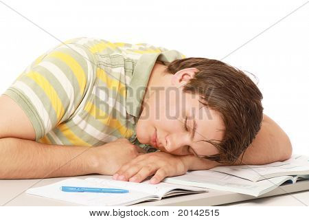 A young guy sleeping on the desk