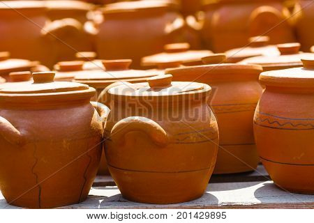 Clay pots from local pottery market in street
