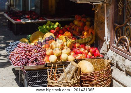 Street Marketplace With Apples, Grapes And Other Fresh Fruits