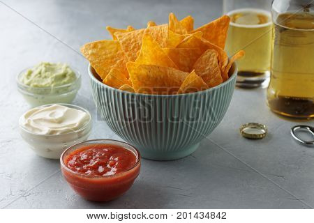 Mexican Snack Tortilla In Blue Bowl With Dip Sauces And Beer On The Table.